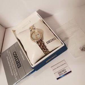 Seiko ladies' silver-gold solar watch w/crystals